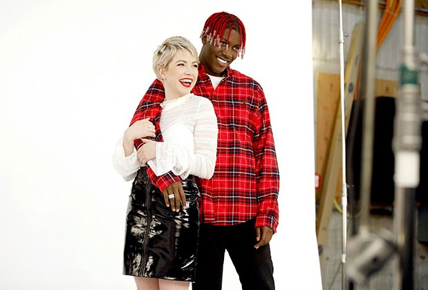 Carly Rae Jepsen and Lil Yachty pose against a white screen on the set of their GRAMMYs commercial