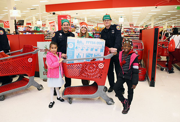 Law enforcement officers stand ready to shop for gifts with kids at a New York store
