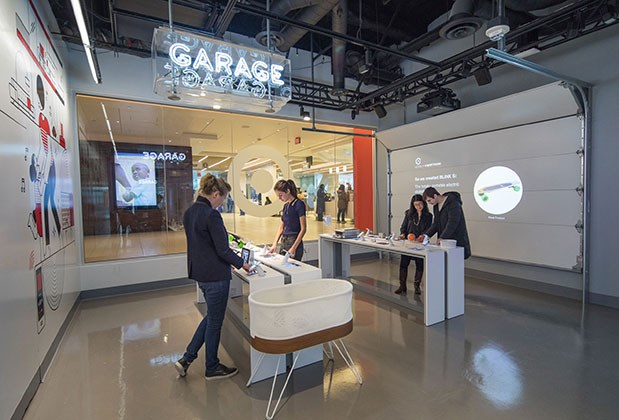 "Visitors interact with smart home products in the new ""Garage"" showroom at Target Open House"