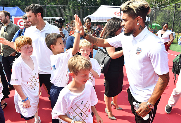 Josef Martinez high-fives kids at the new Target play space in Atlanta