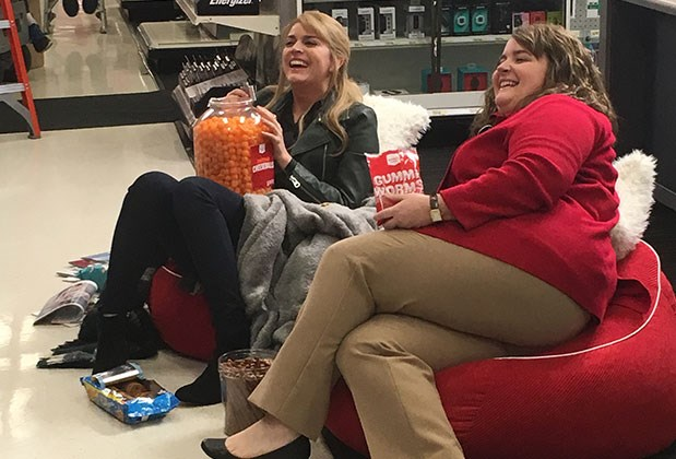 Saturday Night Live cast members Cecily Strong and Aidy Bryant recline in beanbags