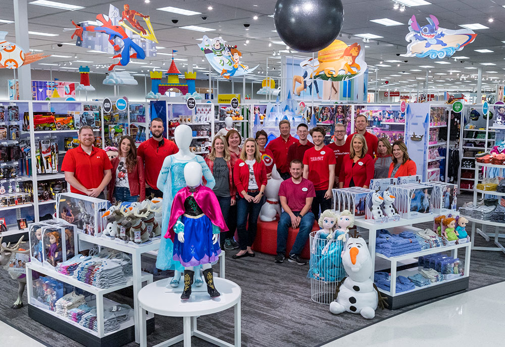 group of Target team members in red and denim in the new Disney store at Target space