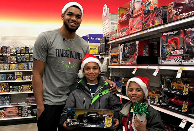 Timberwolves star Karl Towns and two kids with carts and toys