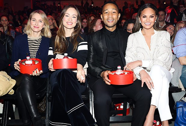 Naomi Watts, Olivia Wilde, John Legend and Chrissy Teigen sitting in the audience with red swag bags