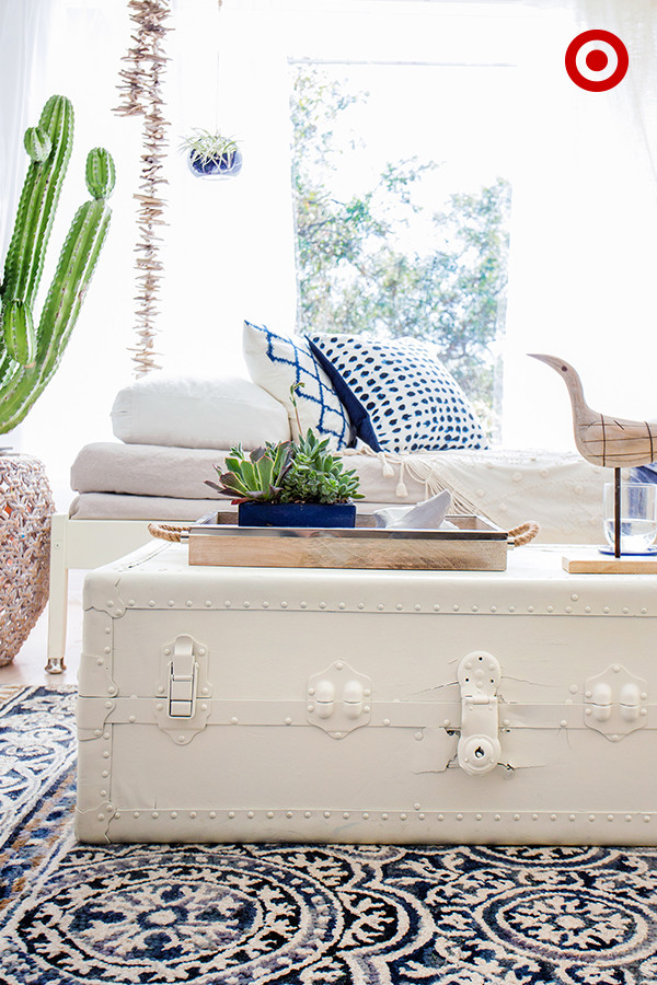 Bright Sunroom With Vintage White Trunk Couches Blue Accents And Succulents