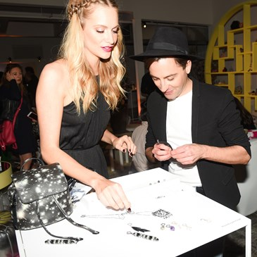 Poppy Delevingne and Eddie Borgo chat at the maker bar