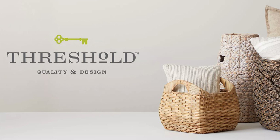 Threshold logo next to arrangement of neutral baskets and pillows