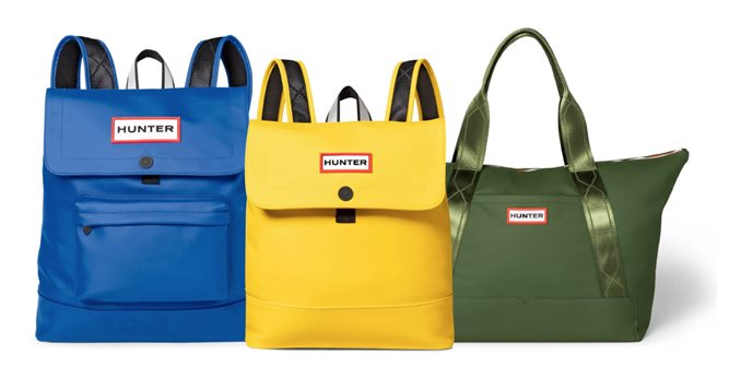 Three Hunter backpacks and bags in blue, green and yellow