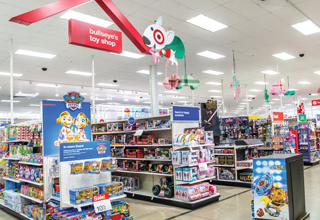 Bullseye's Toy Shop signage hangs above Target toy aisles